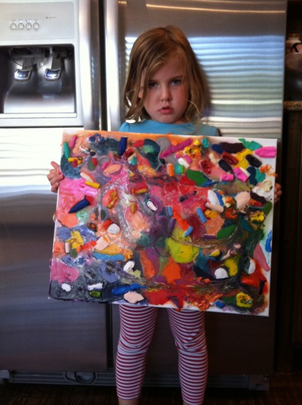 Sad little girl with sad little crayon project.